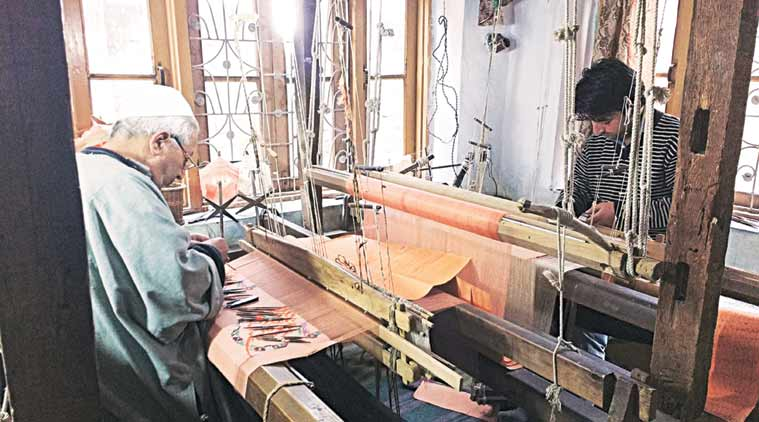 A father and son Kani weaving in Kashmir.