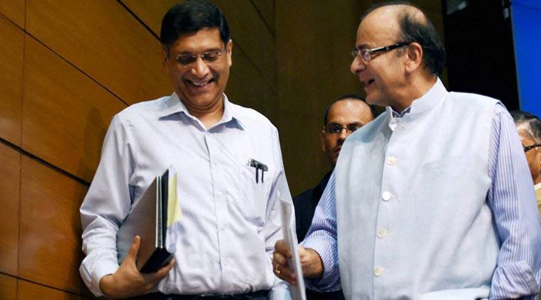 Union Finance Minister, Arun Jaitley with Chief Economic Advisor Arvind Subramanian after a Press Conference on the Goods and Services Tax in New Delhi on Thursday. (PTI Photo)