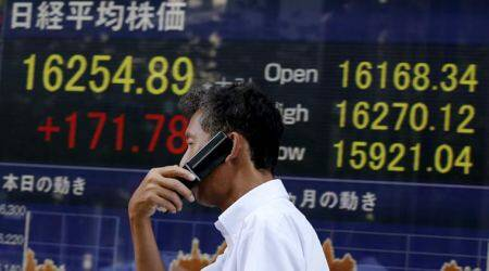 Nikkei falls in choppy trade after weak US data overshadows Fed hike