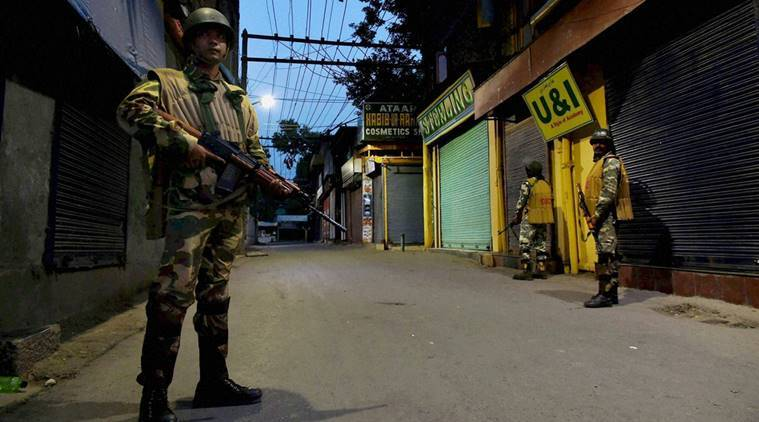 Srinagar: Security jawans stand guard during night curfew in Lal Chowk area of Srinagar on Sunday. Security has been stepped up in Kashmir for the Independence Day functions. PTI Photo by S Irfan  (PTI8_15_2016_000076B)