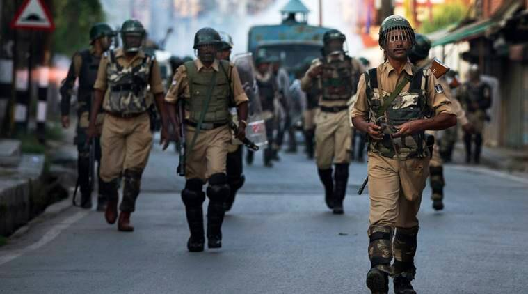 Indian paramilitary soldiers walk back towards their base camp after a day long curfew in Srinagar, Indian controlled Kashmir, Saturday, Aug. 13, 2016. (Source: AP)