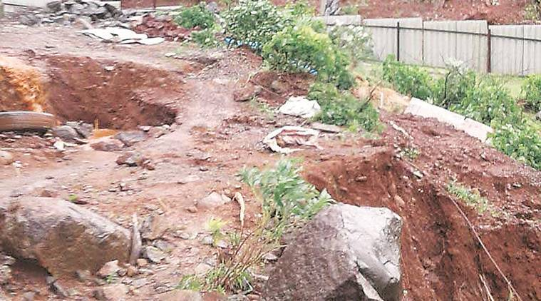 Landslide in Lavasa near Ekaant resort on Wednesday. The work to clea the debris was on till Thursday evening.Express Photo,04.08.16,Pune