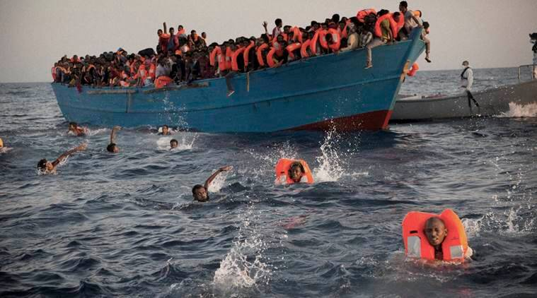 Mediterranean sea : Migrants, most of them from Eritrea, jump into the water from a crowded wooden boat as they are helped by members of an NGO during a rescue operation at the Mediterranean sea, about 13 miles north of Sabratha, Libya, Monday, Aug. 29, 2016. Thousands of migrants and refugees were rescued Monday morning from more than 20 boats by members of Proactiva Open Arms NGO before transferring them to the Italian cost guards and others NGO vessels operating at the zone. AP/PTI(AP8_29_2016_000195A)