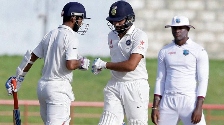 West Indies bowl, India drop Pujara and include Rohit