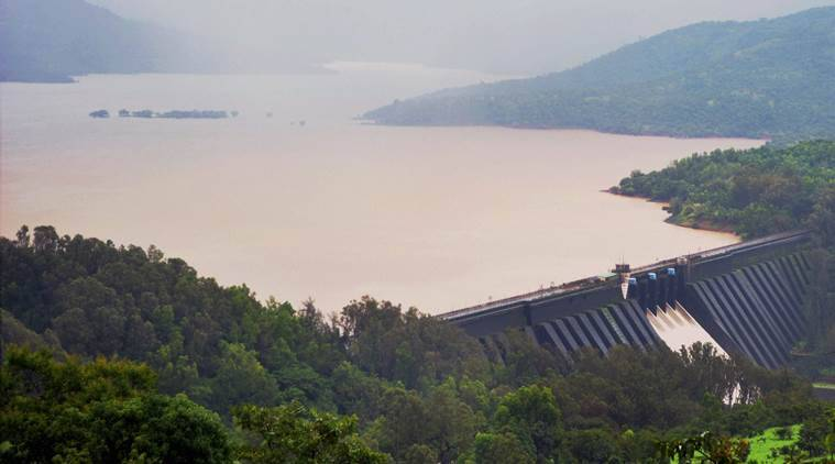 Satara: Water being discharged from Koyna Dam in Satara, Maharashtra on Sunday. PTI Photo (PTI8_7_2016_000165A)
