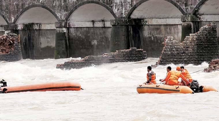 Rescue operations being carried out at the site of the Mahad bridge collapse. (Express Photo by Narendra Vaskar)