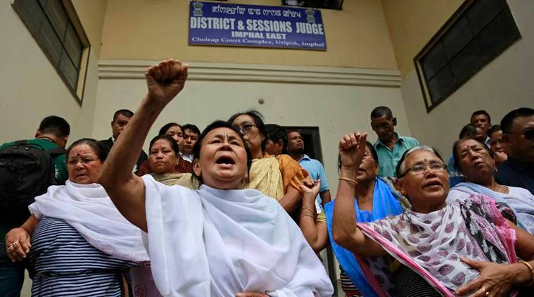 Manipuri human rights activists shout against the decision of hunger-striking activist Irom Sharmila to break her fast in Imphal, north-eastern Indian state of Manipur, India, Monday, Aug. 9, 2016. An Indian court has granted bail to the activist who has been force-fed for nearly 16 years, after she assured the judge that she planned to end her fast. Babloo Loitongbam, a rights activist close to Sharmila, says he expects her to be freed later Tuesday, once the paperwork is processed. (AP Photo/Anupam Nath)