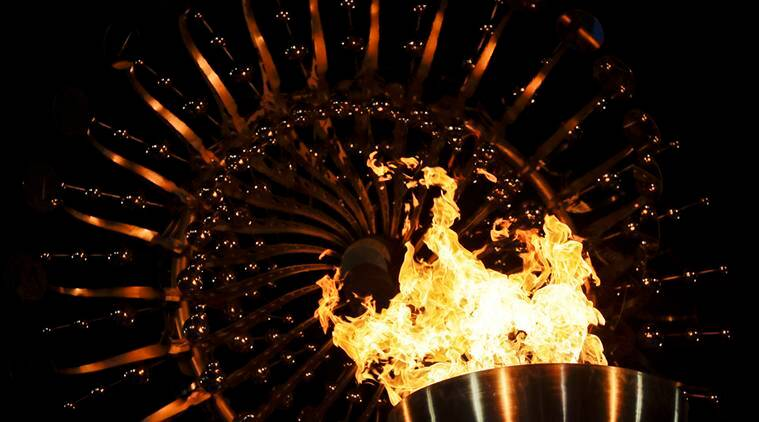 FILE - In this Saturday, Aug. 6, 2016, file photo, flames burn in the Olympic cauldron after being lit during the opening ceremony of the 2016 Summer Olympics in Rio de Janeiro, Brazil. The Rio Games officially end with a closing ceremony Sunday, Aug. 21. (AP Photo/Gregory Bull, File)