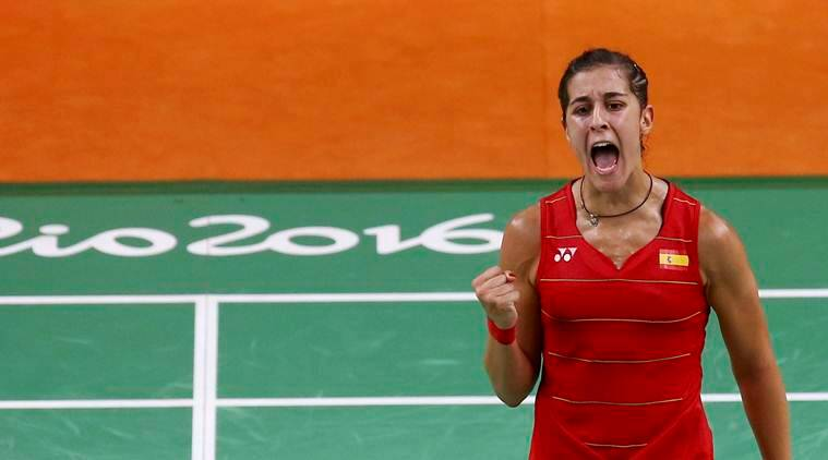 2016 Rio Olympics - Badminton - Women's Singles - Semifinals - Riocentro - Pavilion 4 - Rio de Janeiro, Brazil - 18/08/2016. Carolina Marin (ESP) of Spain celebrates a point during her match against Li Xuerui (CHN) of China. REUTERS/Marcelo del Pozo FOR EDITORIAL USE ONLY. NOT FOR SALE FOR MARKETING OR ADVERTISING CAMPAIGNS.