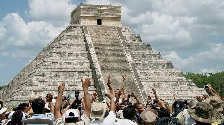 Villagers and tourists celebrate next to the Kukulkan pyramid at the Mayan ruins of Chichen Itza in Mexico's Yucatan peninsula (Source: Victor Ruiz/Reuters)