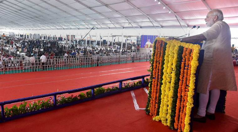 Prime Minister Narendra Modi addresses at the inauguration of the first phase of Saurashtra Narmada Avataran for Irrigation (SAUNI) project in Rajkot on Tuesday. PTI Photo