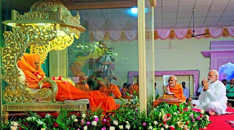 Sarangpur: Prime Minister Narendra Modi paying tributes to the mortal remains of Swaminarayan sect's spiritual head Pramukh Swami at a temple in Sarangpur on Monday. PTI Photo (PTI8_15_2016_000424A) *** Local Caption ***