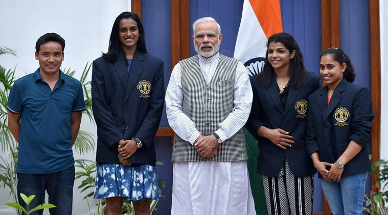 Prime Minister Narendra Modi poses with Olympic Medal Winners, Khel Ratna Awardees in New Delhi on Sunday. The players are silver medallist shuttler P V Sindhu (2L) bronze medal winning wrestler Sakshi Malik (2R), gymnast Dipa Karmakar (R) and ace shooter Jitu Rai. (PTI Photo)
