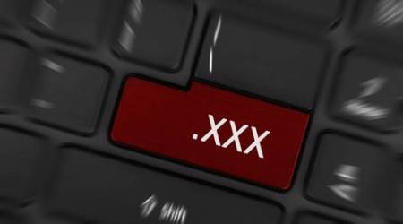 Wanting to watch porn, pressing porn button on a computer keyboard