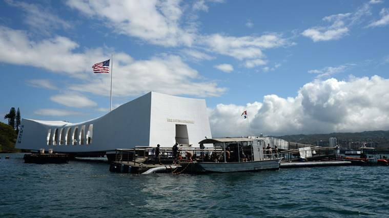 "FILE- In this June 3, 2015 file photo provided by the U.S. Navy, sailors work to repair the floating dock next to the USS Arizona Memorial in Pearl Harbor, Hawaii, after the USNS Mercy hospital ship struck the memorial's dock in May as it was leaving Pearl Harbor. Japan's first lady has visited Pearl Harbor for the first time to pay tribute to the victims of the Japanese attack 75 years ago. Akie Abe said in her Facebook entry Monday, Aug. 22, 2016, that she laid flowers and prayed at the USS Arizona Memorial. ""I offered flowers and a prayer,"" she wrote in a short message. (Laurie Dexter/The U.S. Navy via AP, File)"