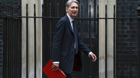 British finance minister Philip Hammond urges party to unite on Brexit, says EU is 'the enemy'