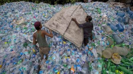 Rag pickers collecting plastic bottles