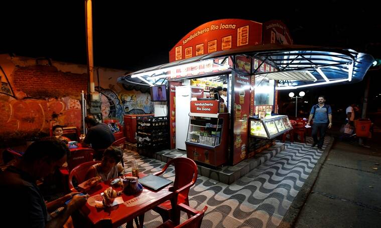 """A view of a kiosk selling podrao, the Portuguese word for 'rotten' (a hotdog or burger type sandwich assembled according to taste), is seen in Rio de Janeiro, Brazil, April 8, 2016. REUTERS/Sergio Moraes SEARCH """"RIO FOOD"""" FOR THIS STORY. SEARCH """"THE WIDER IMAGE"""" FOR ALL STORIES."""