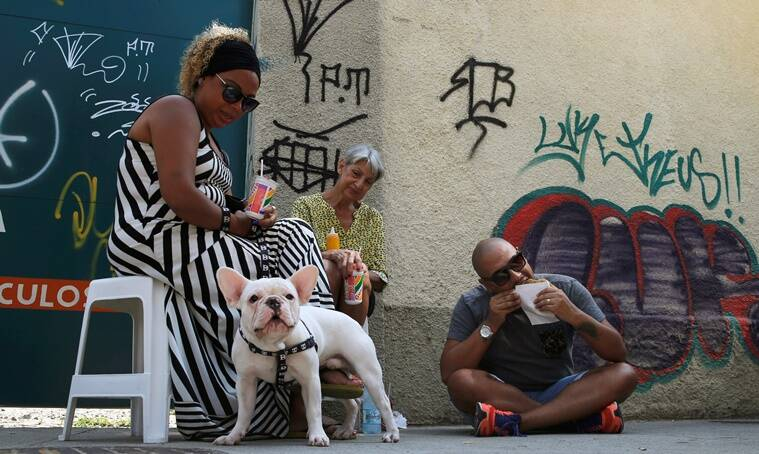 """People eat street market-purchased food and drinks including pasteis de feira (pastries) in Rio de Janeiro, Brazil, May 7, 2016. REUTERS/Sergio Moraes SEARCH """"RIO FOOD"""" FOR THIS STORY. SEARCH """"THE WIDER IMAGE"""" FOR ALL STORIES."""