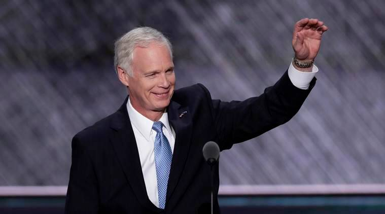 "FILE - In this July 19, 2016 file photo, Sen. Ron Johnson, R-Wis., who is running against Democratic Senate candidate Russ Feingold in the November election, waves to the delegates during the Republican National Convention in Cleveland. Feingold had harsh words for Republican presidential nominee Donald Trump on Wednesday, July 27, 2016, calling him unfit to be president and questioning how much longer his Republican opponent, Johnson, could support Trump. Johnson, who has said he supports but does not endorse Trump, said through a spokesman that Russia should ""stay out of our elections."" (AP Photo/J. Scott Applewhite, File)"