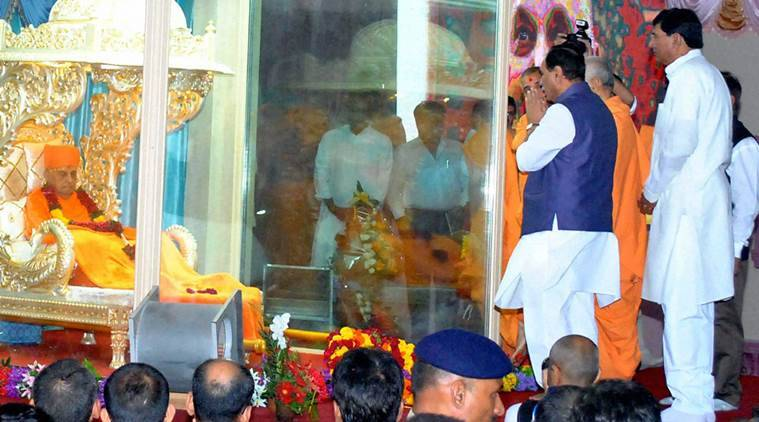 Gujarat Chief Minister Vijay Rupani pays homage to president of the BAPS Swaminarayan Sanstha Shri Pramukh Swami Maharaj at  Shri Swaminarayan temple in Sarangpur, on Sunday. PTI Photo