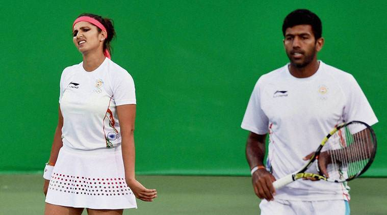 Rio de Janerio: India's Sania Mirza and Rohan Bopanna leave the court after losing the mixed-doubles semifinal match against Venus Williams and Rajeev Ram of USA at the 2016 Summer Olympics in Rio de Janerio, Brazil on Satuday. PTI Photo by Atul Yadav (PTI8_14_2016_000090B)