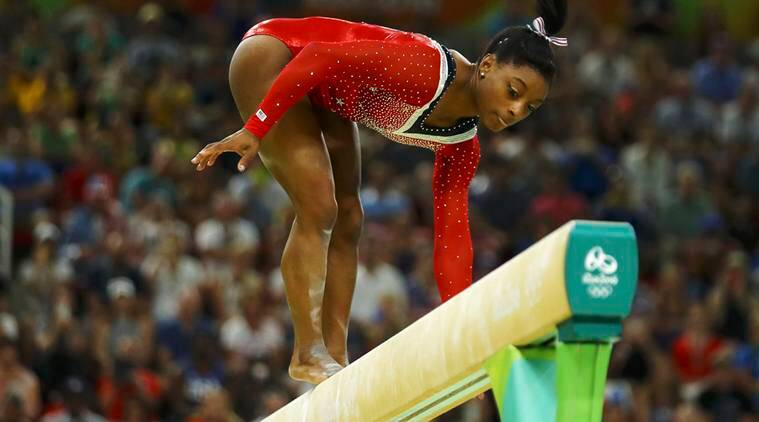 Olympic champion Simone Biles returns to gym with new coach Laurent Landi