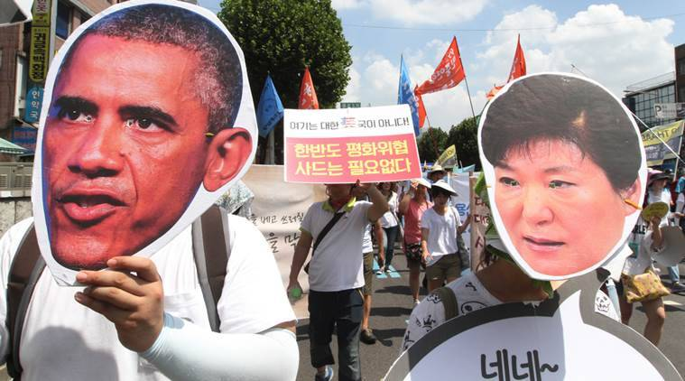 South Korean protesters wearing masks of US President Barack Obama and South Korean President Park Geun-hye, march to oppose a plan to deploy an advanced US missile defense system called Terminal High-Altitude Area Defense, or THAAD, in Seoul, South Korea, Monday, Aug. 15, 2016. (AP Photo/Ahn Young-joon)