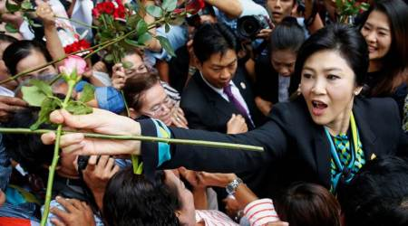 Supporters cheer for former Thai Prime Minister Yingluck Shinawatra as her trial enters final hearing day