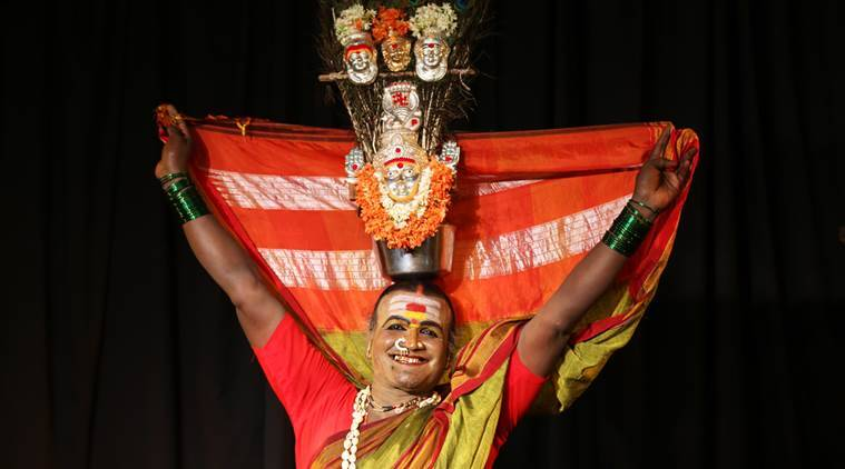A transgender B. Manjamma Jogathi carries a vessel with images of Hindu goddess Renuka or Yellamma, her patron goddess, as she poses for a portrait after performing at the International Trans Art Festival in Bangalore.  (Source: AP)