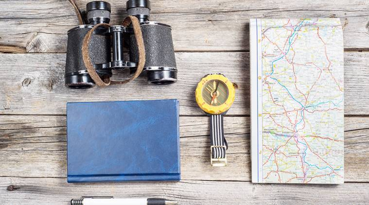 Traveler's equipment include map binocullars notebook pen and compass