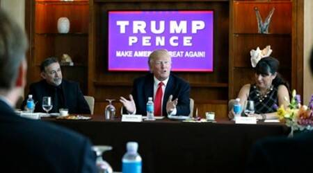 Republican presidential candidate Donald Trump leads a Hispanic leaders and small business owners roundtable in Las Vegas, Friday, Aug. 26, 2016. Left is Pastor Pasqual Urrabazo, of the International Church of Las Vegas, and right is Irma Aguirre, a local business owner. (AP Photo/Gerald Herbert)