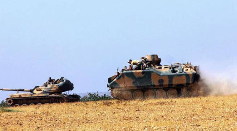 For the first time, Turkish armor crosses into Syria to battle ISIS