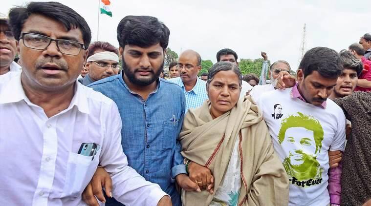 Una :  Rohit Vemula's mother and brother with Dalit community members during a solidarity rally in Una on Monday. PTI Photo    (PTI8_15_2016_000348A)