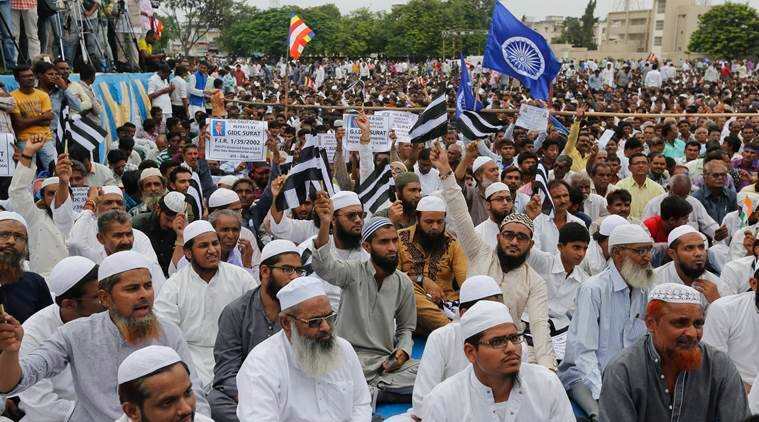 Muslims and hundreds of members of India's low-caste Dalit community gather for a rally in Una, Gujarat state, India, Monday, Aug. 15, 2016. The Dalits have been protesting since four men belonging to their community were beaten while trying to skin a dead cow in July near this western Indian town. Videos of the four being stripped and beaten with sticks by men claiming to be cow protectors in Gujarat state had gone viral and sparked protests by Dalit groups across India. The Dalits, belong to the lowest rung of Hinduism's caste hierarchy. (AP Photo/Ajit Solanki)