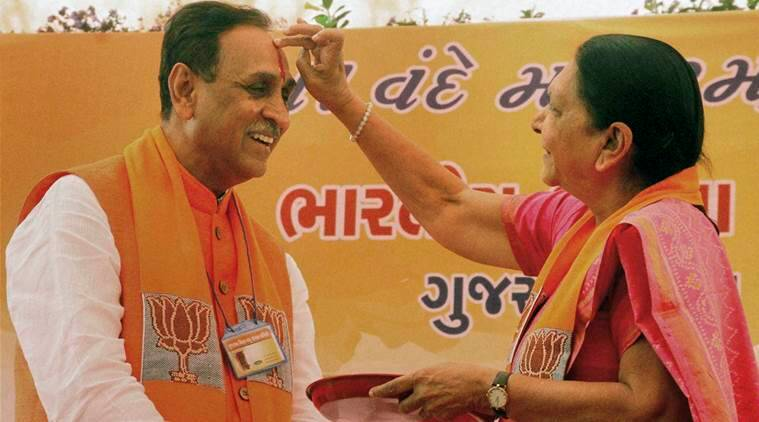 Gandhinagar : File photo of Vijay Rupani with the then Chief Minister Anandiben Patel in Gandhinagar in Feb 2016. Rupani was on Friday chosen by the Gujarat BJP as the State's next Chief Minister. PTI Photo (PTI8_5_2016_000303B)