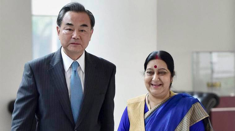 Visiting Chinese Foreign Minister Wang Yi, left and India's External Affairs Minister Sushma Swaraj arrive for a meeting in New Delhi, India, Saturday, Aug.13, 2016. (Kamal Kishore/Press Trust of India via AP)