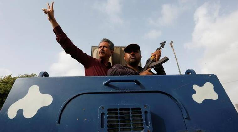 Waseem Akhtar, mayor nominee of Muttahida Qaumi Movement MQM, gestures from an armoured personal carrier while being taken to jail after his arrest from Anti Terrorism Court ATC, in Karachi, Pakistan, July 19, 2016. (Source: Reuters/file)