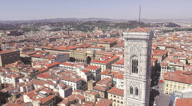 A view of the sea of tiled roofs and yellow walls from the bell tower in Duomo