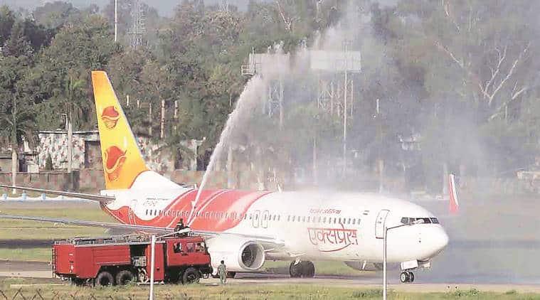 Chandigarh International airport, Air India Express Flight, Air India Express Flight water salute, International flight passengers, International airport, Airports Authority of India, Sukhbir singh badal, chandigarh, India news