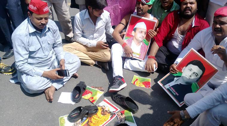 Uttar pradesh chief minister Akhilesh Yadav supporters set their shoes on party leader Amar Singh's Picture during their protest against party decision on part's state president ship,protestors are saying they dont want to work under newly apointed state president Shivpal Singh yadav.Express photo by Vishal Srivastav 17.06.2016