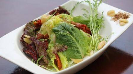 Enjoy good health with this Almond and Oven Dried Tomato Salad recipe