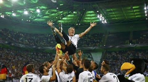 Bastian Schweinsteiger bows out as Germany beat  Finland 2-1