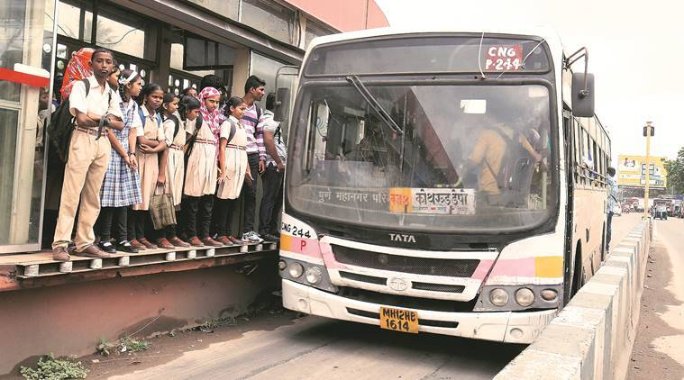 The Sangamwadi bus stand has become a death trap for commuters, including children, due to the malfunctioning automatic doors. Buses move here precariously close to the bus stop, which can prove dangerous for commuters waiting at the stop. (Express Photo Arul Horizon)