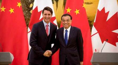 Beijing : Canada's Prime Minister Justin Trudeau, left, and China's Premier Li Keqiang, right, shake hands as they pose for a photo at the end of a joint press conference at the Great Hall of the People in Beijing, Wednesday, Aug. 31, 2016. AP/PTI(AP8_31_2016_000013B)