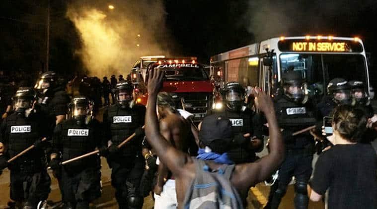 North Carolina, protest, protests, violent protests, police officers hurt, fatal shooting, police shooting, African american, Black man killed, black man shot, black lives matter, slogan, protest slogan, world news, indian express