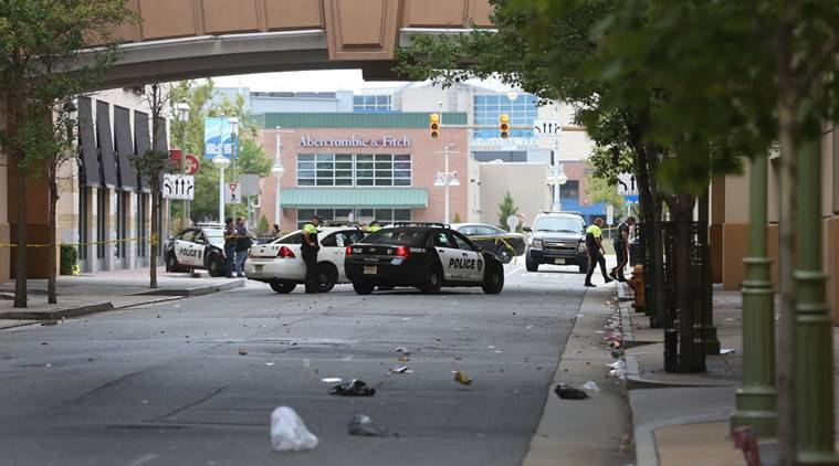 Police investigate the scene of a shooting on Saturday, Sept. 3, 2016 in Atlantic City, N.J.    Authorities say a New Jersey police officer remains in critical condition after he was shot during an exchange of gunfire outside an Atlantic City casino. Acting Atlantic County Prosecutor Diane Ruberton said  that the officer underwent surgery Saturday morning after the shooting that left one suspect dead. (Ben Fogletto /The Press of Atlantic City via AP