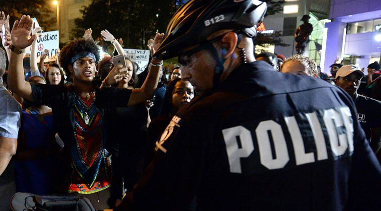 Charlotte protests, Charlotte police shooting, Charlotte black man shooting, Charlotte shooting police tape, news, US news, Charlotte curfew, world news, international news, latest news, Keith Lamont Scott