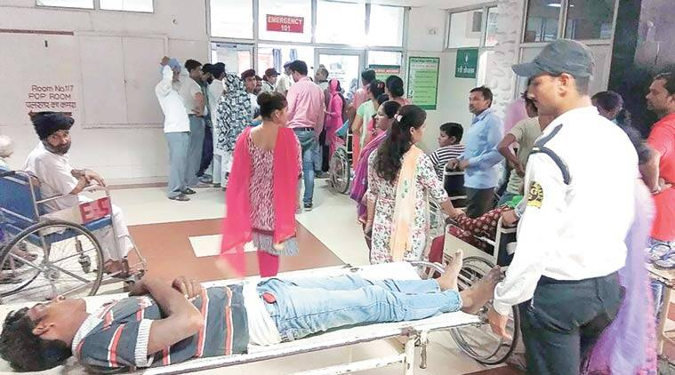 Patients in queue outside emergency ward at Government Hospital in Chandigarh on Tuesday. (Express Photo by Sahil Walia)