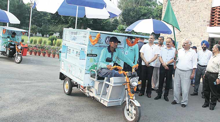UT Administrator V P Singh Badnore flags off e-water ATM vans on Tuesday. (Express Photo)